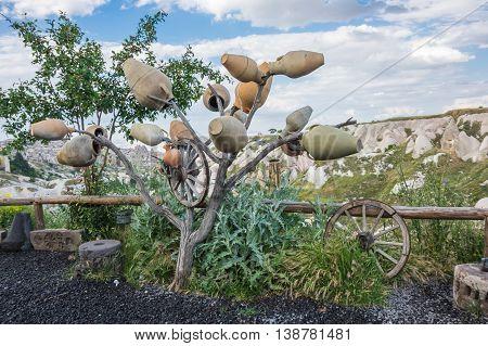 Tree with old ceramic pots in Cappadocia Turkey