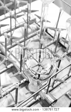 Flasks and test tubes installed in the tray of industrial dishwasher mashiny. shallow depth of field.. Industrial background.
