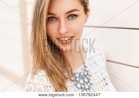 Cheerful Young Beautiful Woman With A Smile And Blue Eyes Looking Into The Camera
