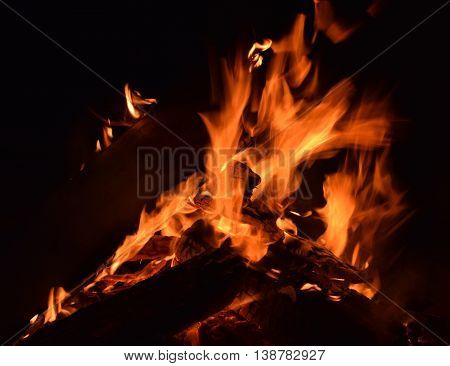 Night time image of a brightly burning campfire