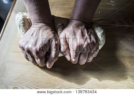 Woman hands kneading the dough close up
