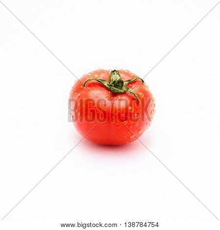 A Red Tomato In Water Drops Isolated On White Background