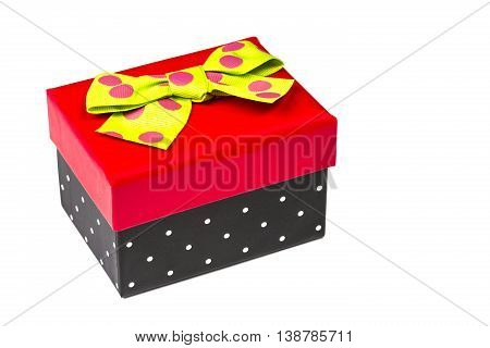Funny red and black gift box with green ribbon isolated on white background