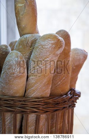 Fresh tasty wholemeal baguettes in a basket