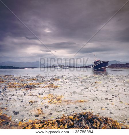 Fishing Boats at Low Tide on the Isle of Skye in Scotland