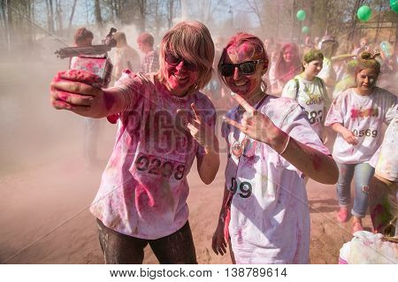 SAINT-PETERSBURG RUSSIA - May 03 2016: Holi festival of colors in Saint-Petersburg Russia.