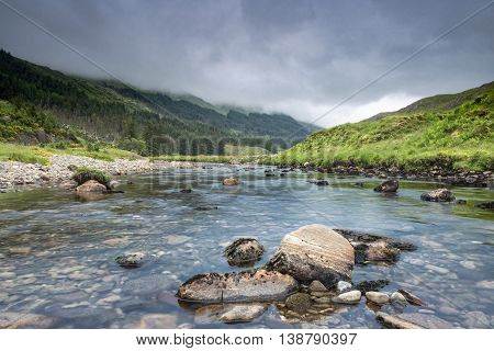 Rainy Clouds over Crystal Clear River Among Scottish Highlands