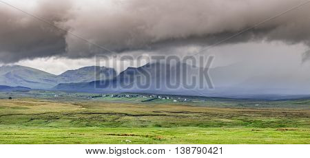Rainy Dramatic Clouds over Scottish Highlands on the Isle of Skye