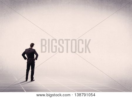 Office worker with briefcase standing with his back facing an empty space with filtered color concept