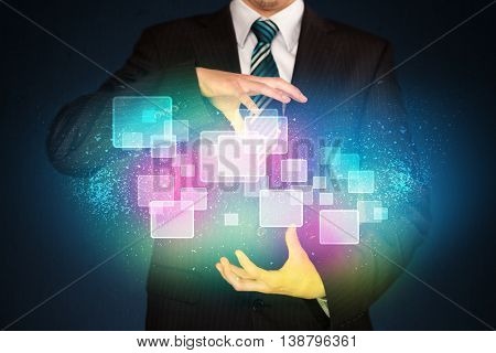 Businessman holding abstract glowing icons