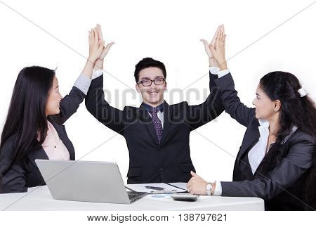 Portrait of cheerful multi-ethnic business team celebrating their victory isolated on white background