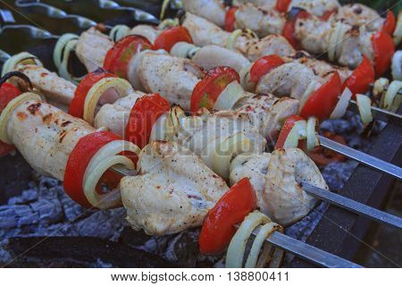 Meat skewers on the barbecue coals. Food