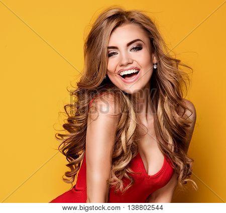 Blonde Pretty Girl Smiling, Posing In Studio.