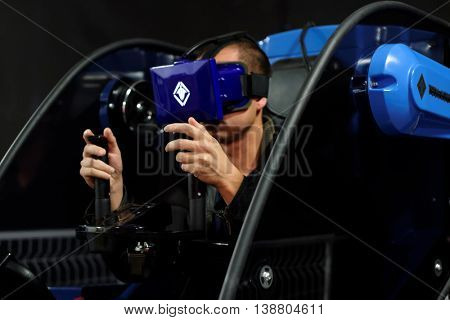 ST. PETERSBURG, RUSSIA - JUNE 28, 2016: Young man with virtual reality headset during the interactive exhibition Ball Of Robots. Last year the exhibition was visited by more than 200,000 people