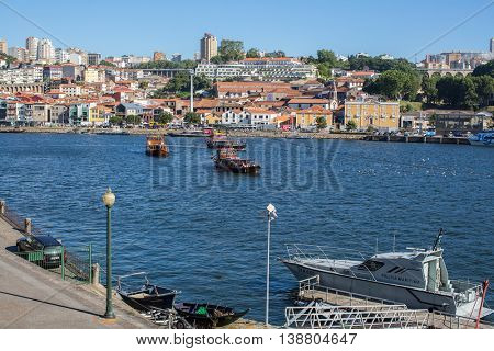 PORTO, PORTUGAL - JUL 8, 2016: Tourist boats on the Douro river at Ribeira, historical center of Porto. City of Porto won the European Best Destination 2012 and 2014 awards.