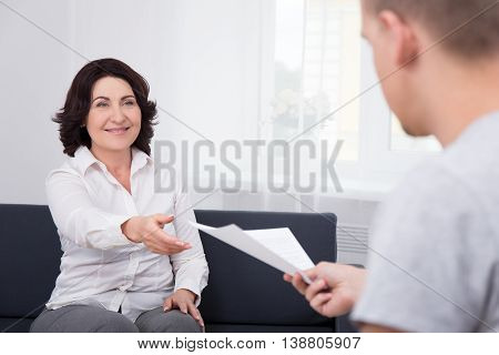 Business Man Giving Document Or Contract To His Colleague