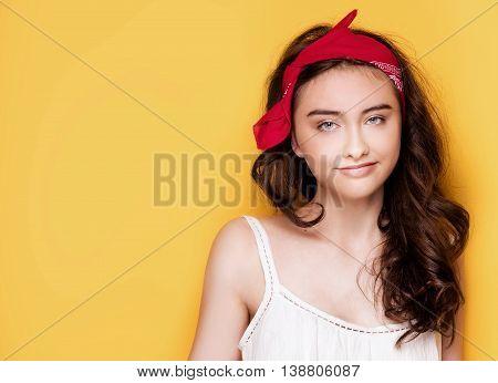 Happy Teenage Girl On Yellow Background.