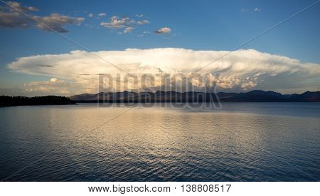 This monster mushrooming cloud billows with light at sunset over Yellowstone Lake