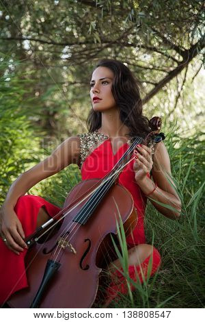 Stylish Woman  With Cello