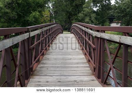 Pedestrians may cross the Du Page River via a pedestrian bridge in Shorewood, Illinois.