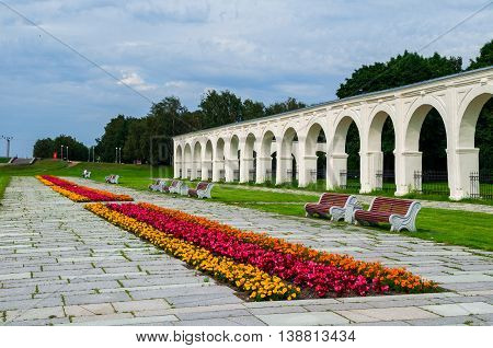 VELIKY NOVGOROD RUSSIA - JULY 15 2016. Embankment and Yaroslav's courtyard arcade in summer cloudy day in Veliky Novgorod Russia - summer architecture cityscape in Veliky Novgorod
