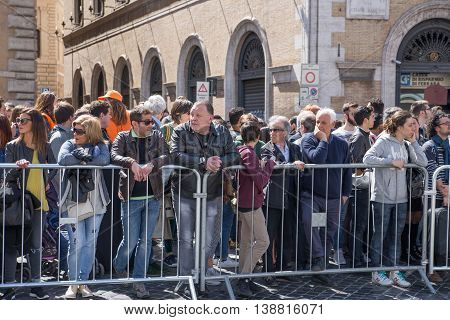 ROME, ITALY - APRIL 8, 2016: Crowd of people during the Roman's marathon waiting to cheering up the sportsmen