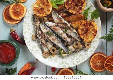 Grilled sardine fish with roasted potato wedges