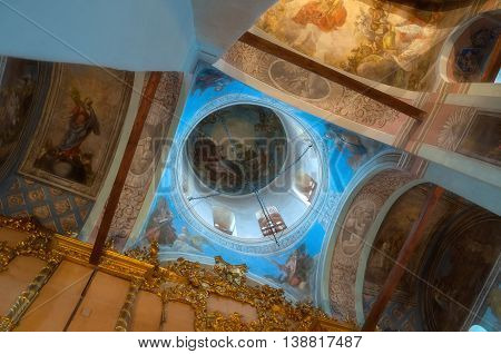 VELIKY NOVGOROD RUSSIA -JULY 15 2016. Decorative architecture details- decorated dome with windows and paintings with Bible scenes - in the interior of Saint Nicholas Cathedral. Soft focus applied