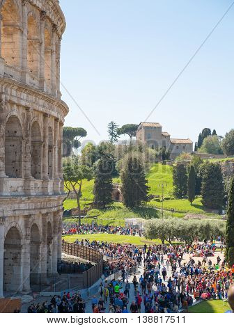 ROME, ITALY - APRIL 8, 2016: Rome;s marathon. Ruins of Coliseum and lots of people on the square during the sport event.