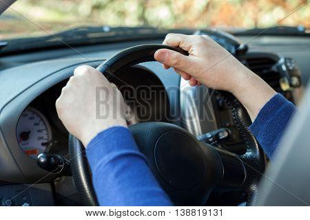 Closeup of a man driving his car