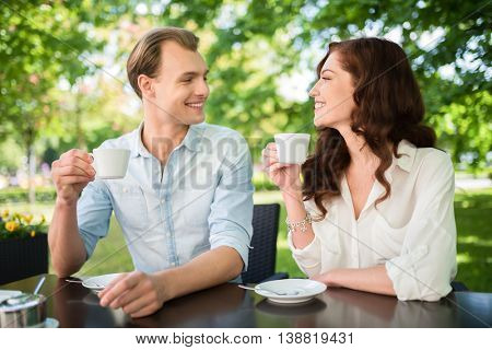 Young couple having a coffee outdoor