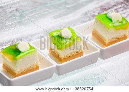 lemon jam custard cake topping with white chocolate on the table