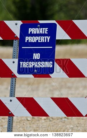 Blue and White Private Property Sign on Construction Barricade