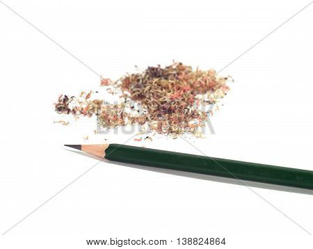sharpened green pencil with a pile of pencil sawdust isolated on white background