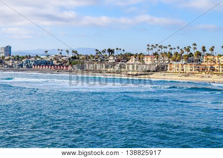 Waves rolling in on the beach in Oceanside, California