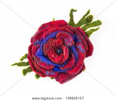 Brooch felted wool in the form of a flower on a white background