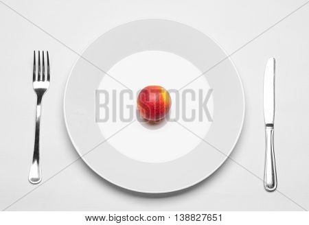 Healthy Eating In The Restaurant And Diet Topic: Beautiful Ripe Nectarine On A White Plate With A Me