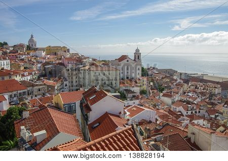 Lisbon, Portugal - March 7, 2010: Lisbon cityscape. View of rooftop in the Alfama District.
