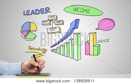 Hand of man using tablet and drawn infographs at background