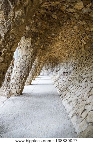 BARCELONA SPAIN - JULY 3 2016: Colonnade of park Guell in Barcelona Spain