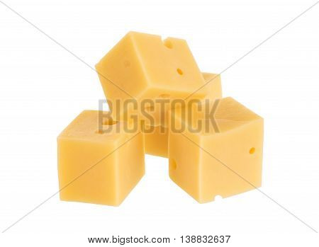 Cubes of cheese with basil leaves isolated on white