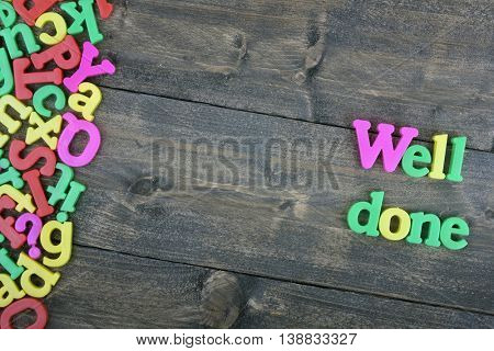 Well done word on wooden table