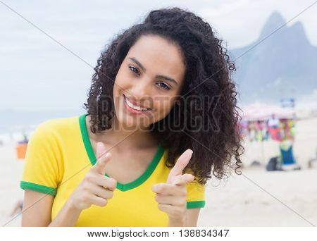 Brazilian sports fan with curly hair at Rio de Janeiro in the summer