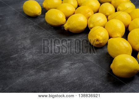 Picture of lemons on grey background. Macro.
