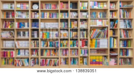 Abstract blur bookshelf in library room
