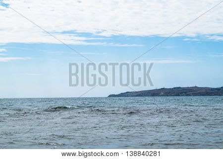 Seascape in a summer day and the sky with billowing clouds
