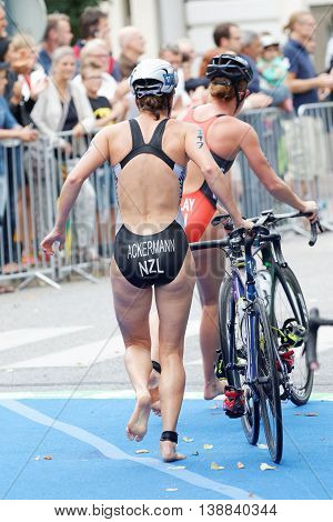 STOCKHOLM - JUL 02 2016: Triathlete Simone Ackermann running with cycle in the transition zone in the Women's ITU World Triathlon series event July 02 2016 in Stockholm Sweden