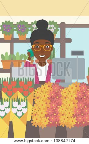 An african-american female florist using telephone and laptop to take orders for flower shop. A florist standing behind the counter at flower shop. Vector flat design illustration. Vertical layout.