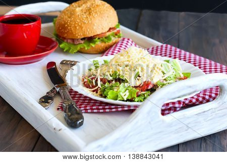 Salad, A Burger And A Cup Of Coffee For Breakfast