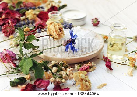 Various dried medicinal herbs, sea salt, essential oil. Flowers of rose, tilia, chamomile, lavender, cornflower.  Extract in bottle. Herbal mixture for relaxing bath tea.